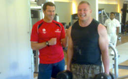 Simon Taufel weight training with Gary Draper